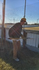 Worker Blake Landry paints the boards of Kirkness rink