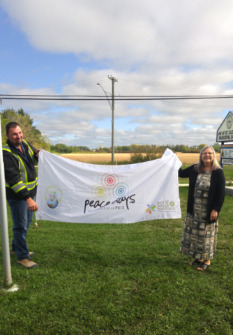 RM of St. Clements Public Works Lead Hand Darren Otto and Mayor Debbie Fiebelkorn with the Rotary Peace Flag on September 19, 2018